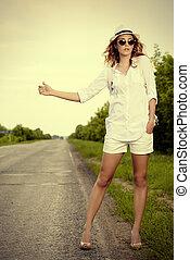 hitchhiking young woman