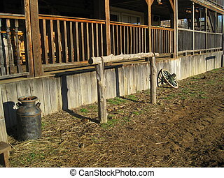 Hitching post next to wagon wheel - Hitching posts in front ...