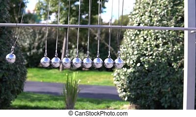 hitting each other metal balls - many metal balls to the...
