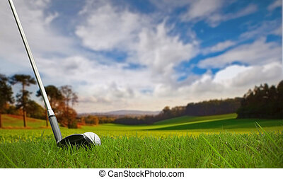hitting golf ball on fairway - hitting golf ball towards...
