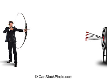 Hitting the target - Businessman with bow and arrows hits...