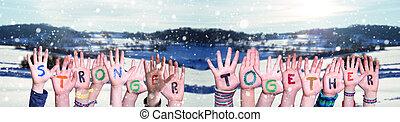 hiver, mot, fond, plus fort, enfants, neigeux, mains ensemble, bâtiment