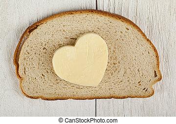 hjärta gestaltade, smör, på, bread
