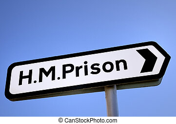 HM Prison Sign - Sign pointing the way to a prison in the...