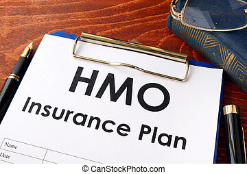HMO Insurance Plan on a table. (Health Maintenance Organization)