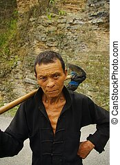 Hmong ethnic peasant - Hmong peasant from the fields. The...