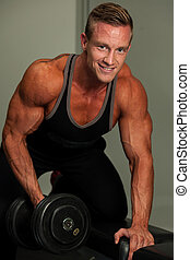 Hnadsome young man working out with