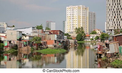 Ho Chi Minh City slums by river, Saigon, Vietnam