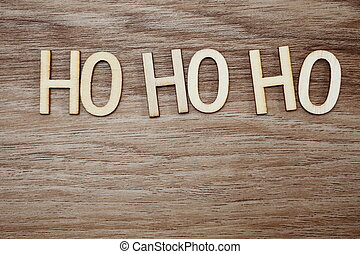 ho ho ho Santa exclamation lettering on wooden background Christmas concept