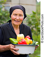 Hoar, old woman - An elderly woman with grizzled hair coming...