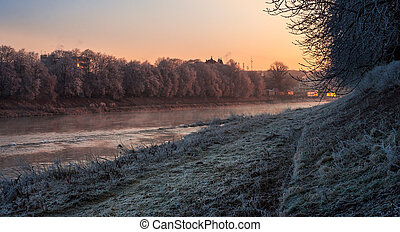 hoarfrost on a winter morning - bank of the river with trees...