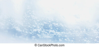 Hoarfrost snowflakes on glass in winter background selective focus