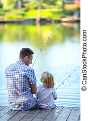 Hobbies - Dad and son fishing on a pier