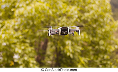 hobby drone with video camera and autumn tree background