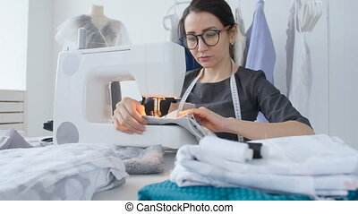 Hobby sewing and a small business concept. Young pretty...