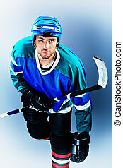 hobby sport - Portrait of a handsome ice-hockey player with...