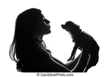 hoben, kugel, aus, ihm, puppy., aussehen, m�dchen, smile., smal, stehende , silhouette, sie, haustier, scene., ausschnitt, wants, kopf, frau, studio, kuß, hands., hübsch, hund, sie