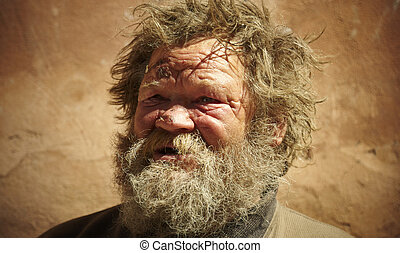 homeless man talking about hard life, special toned photo f/x, focus point on eye