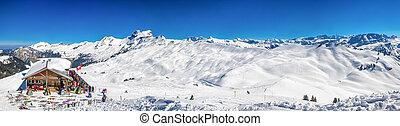 HOCH YBRIG, SWITZERLAND - March 24, 2018 - Beautiful winter landscape. Chalet covered by fresh snow in Hoch Ybrig ski resort, Switzerland, Europe.