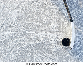 Hockey background - Hockey stick and puck background on ice