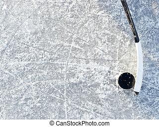 Hockey background - Hockey stick and puck background on ice