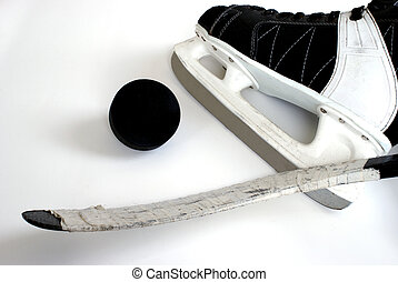 Hockey Equipment - A hockey skate, puck and stick.