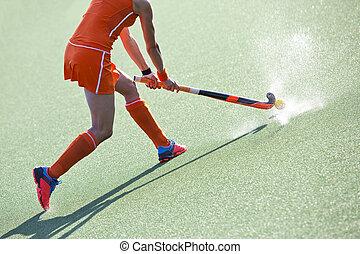 hockey pass - Female field hockey player passing to a team...
