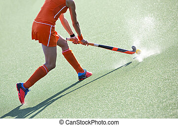 hockey pass - Female field hockey player passing to a team...