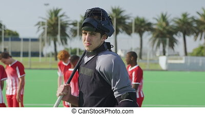 Hockey player before a game - Front view of a Caucasian male...