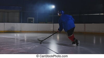 Hockey player conducts an attack on the opponent's goal....