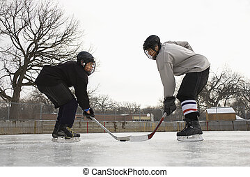 Hockey player face off.