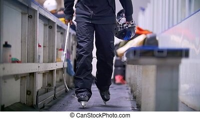Hockey player in skates goes on the site for substitute...