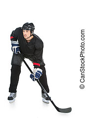 Hockey player is ready to fight of the strike. Standing full length isolated on white