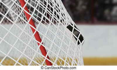 Hockey Puck Flying into Gates Net in Slow Motion with Bright...