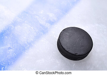 Hockey puck on ice - Vintage old hockey puck is on the ice...