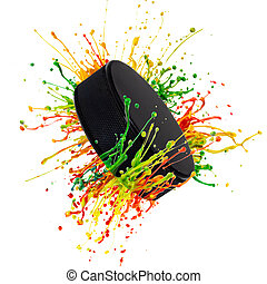 Hockey puck with colorful paint splashing