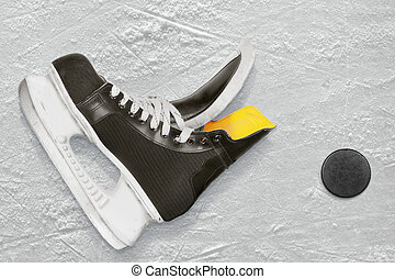 Hockey skates and puck on ice. Texture, background