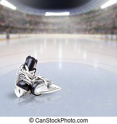 Hockey Skates on Ice of Crowded Arena