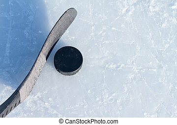 Hockey stick and puck - hockey stick and puck on ice