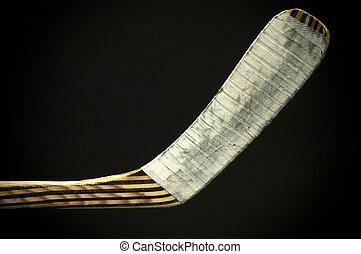 hockey stick - Wooden hockey stick on black background