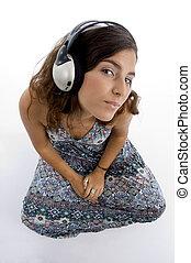 hoek, jonge, koptelefoon, hoog, vrouwlijk, aanzicht