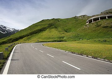 Austria landscape - alpine winding road of Hochalpenstrasse in mountains of Hohe Tauern.