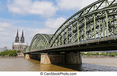 Hohenzollern Bridge and Cologne Cathedral in Cologne,...