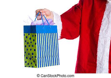 Hohoho - santa clause giving a ift in a bag