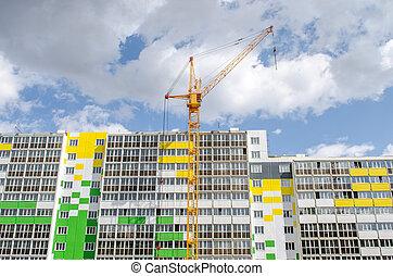 Hoist crane and multistory building