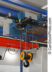 Overhead crane and hoist device mounted on a trolley at beam