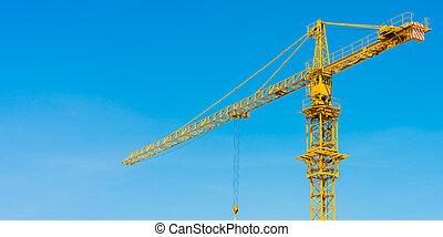 hoisting crane and blue sky