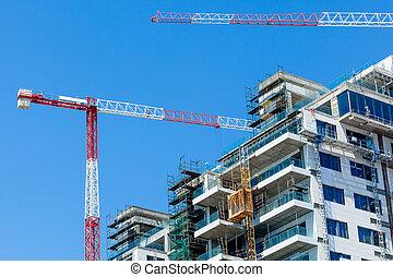 Hoisting crane and house
