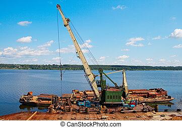 hoisting crane on quay river Volga