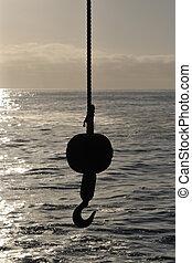 Hoisting crane silhouette